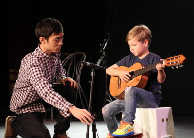 guitar students with a faculty